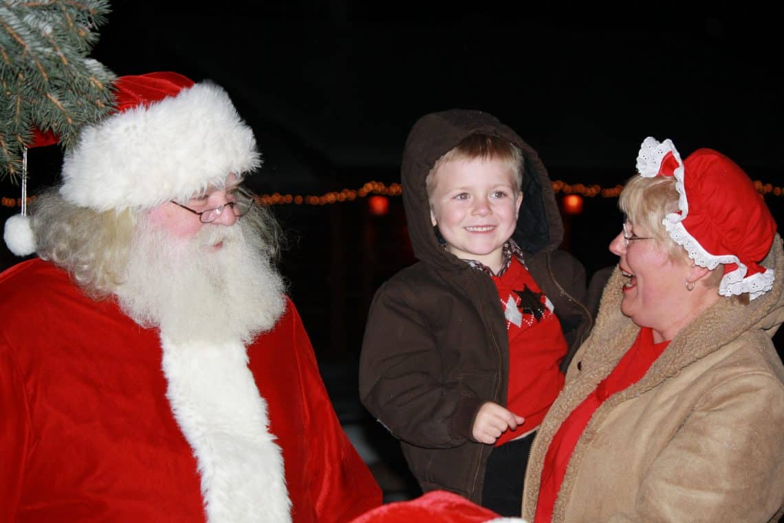 The young man met Mr. and Mrs. Clause last year, and got a special personalized greeting from them again this year. He must have been a very good boy last year!