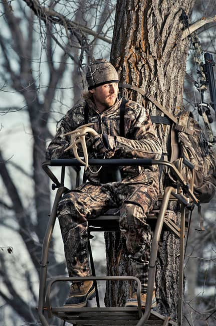"Parker sits in a tree stand, ""calling in the big one"" at the Dick's photo shoot."