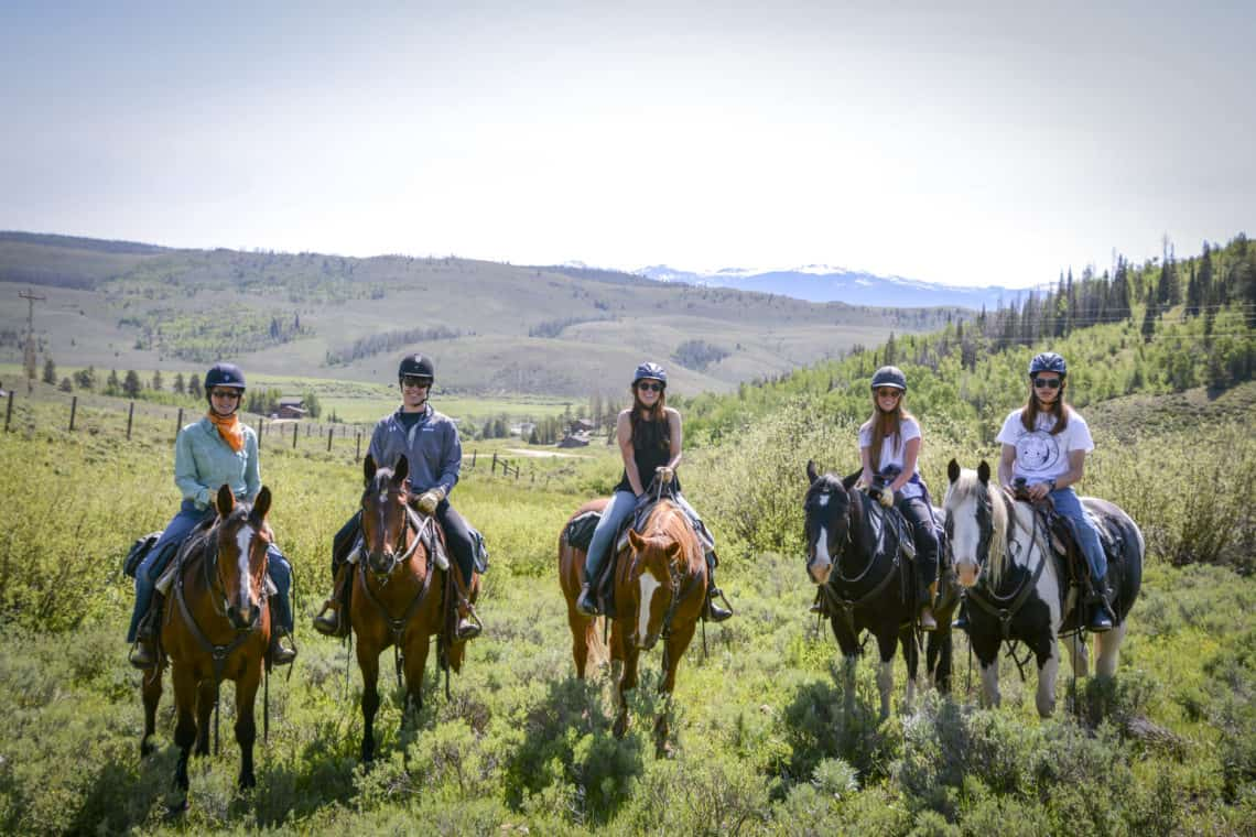 group of riders on horses