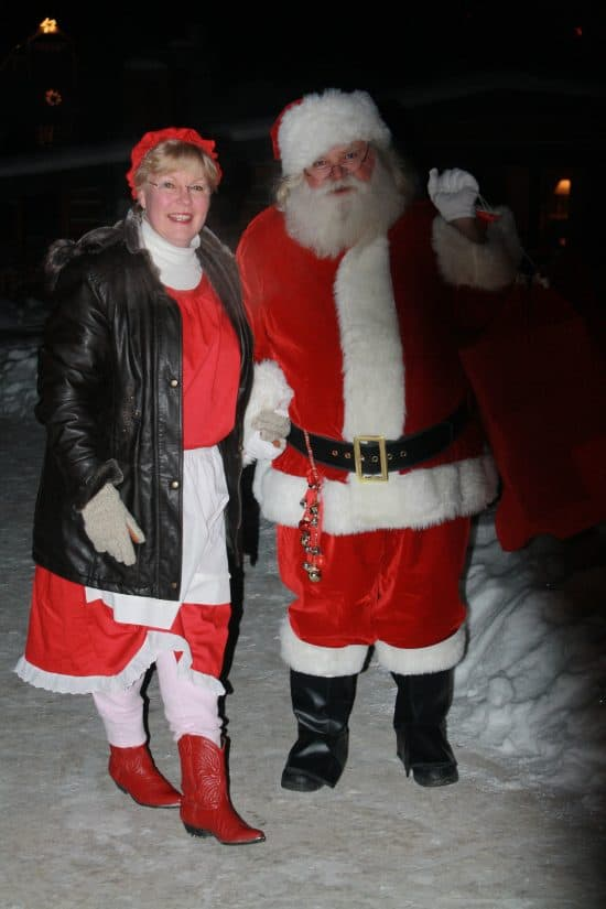 Santa and Mrs. Clause make their way to the lodge