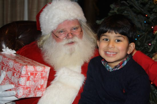Santa and one of the many children on ranch pose for a picture