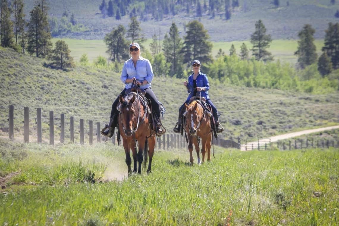 2 women on horses