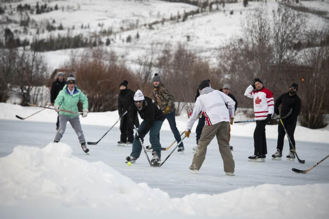 people playing hockey on ice