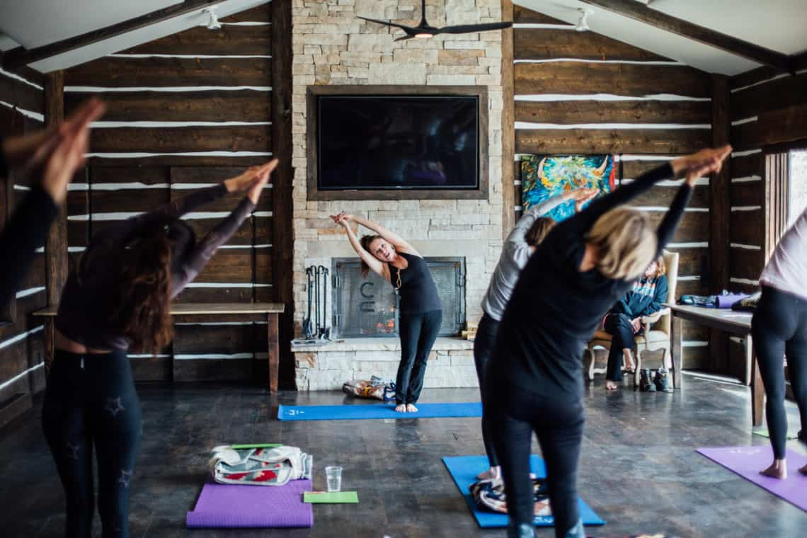women stretching during yoga