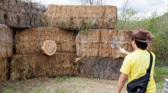 axe throwing at hay bails