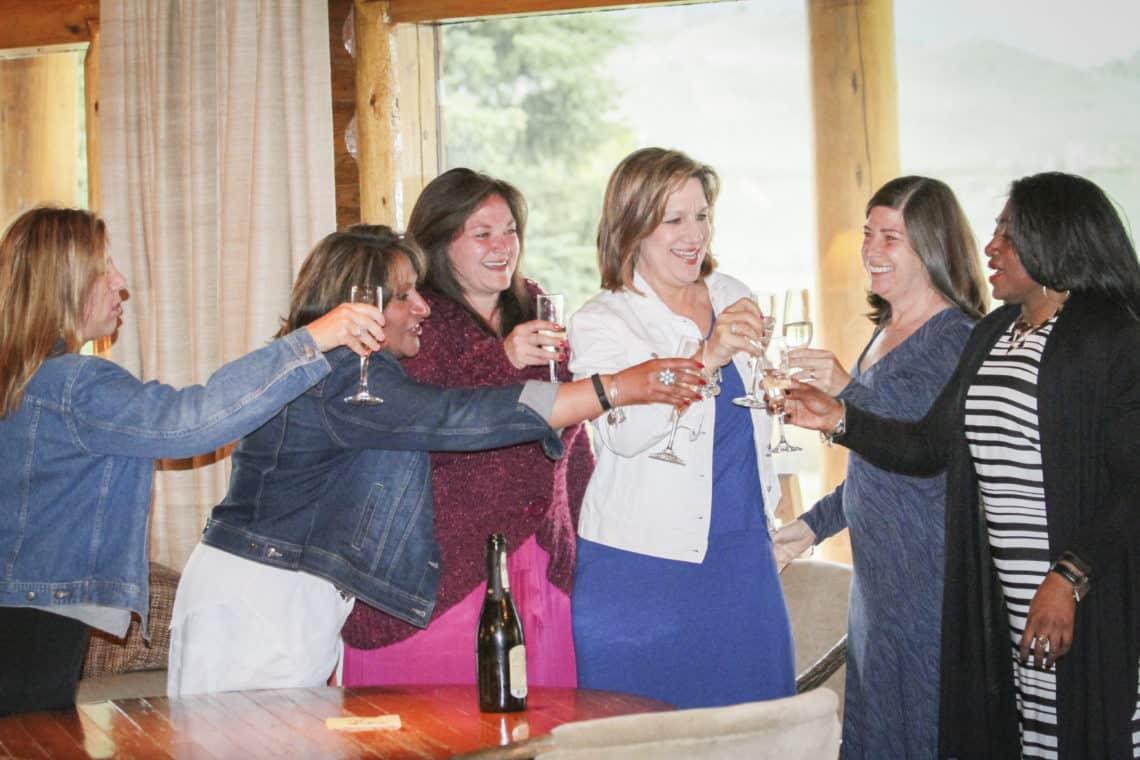 ladies cheersing wine