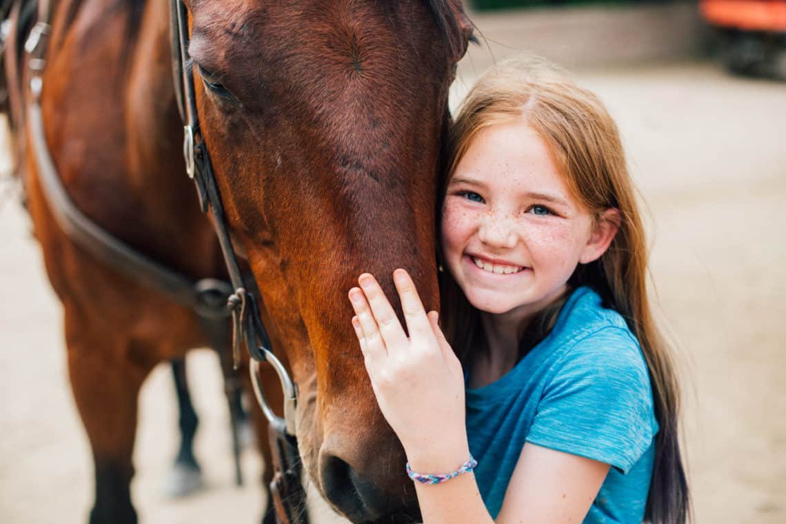 close up of girl with horse