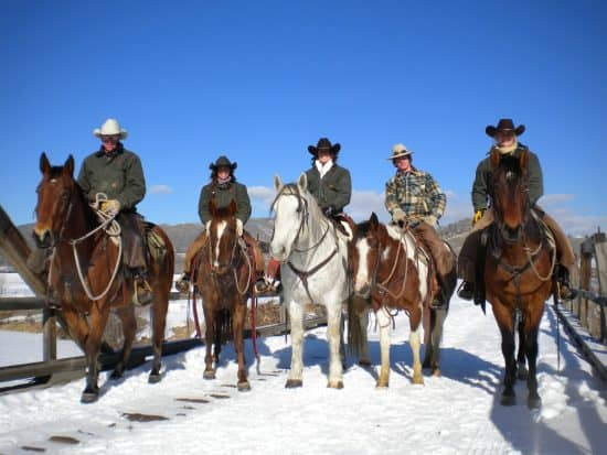 Head Wrangler Bill Fisher, And Wrangler Tyler Klees out for a ride with the first of the winter wranglers.