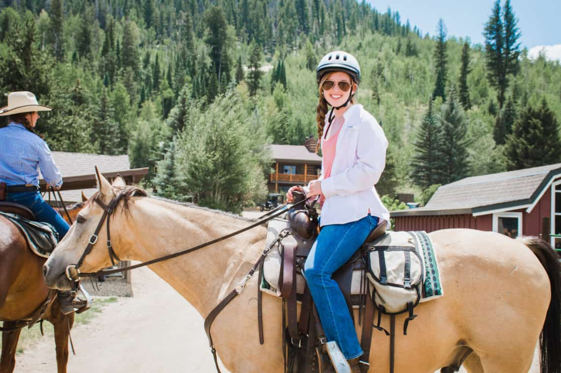 adult riding horses