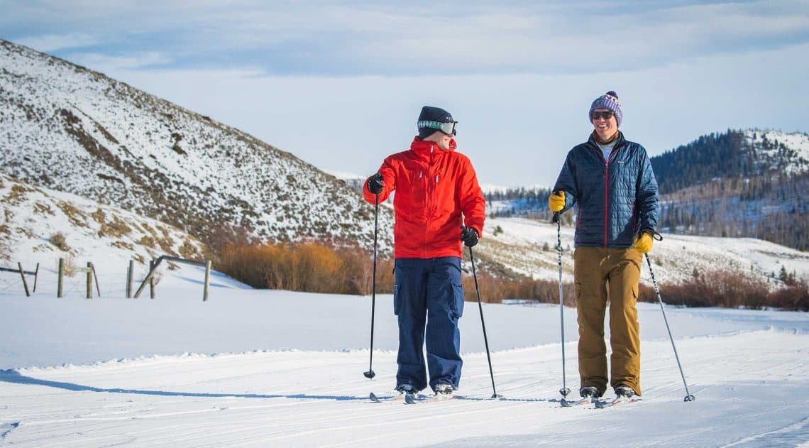 2 friends enjoy cross-country skiing at C Lazy U Ranch