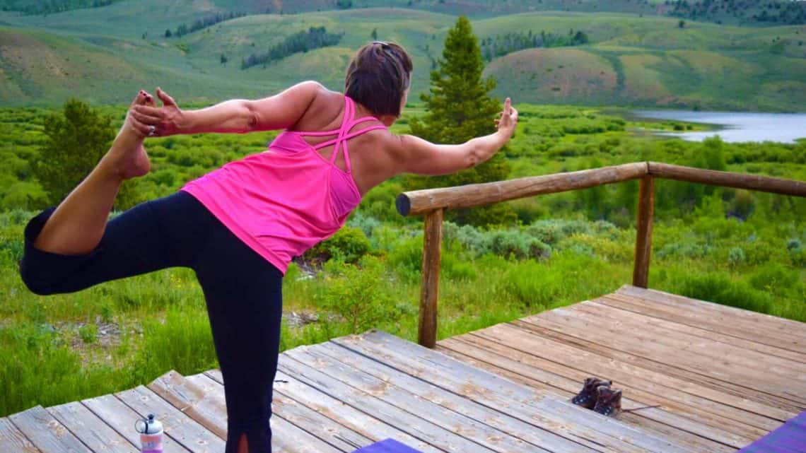 woman in pink doing yoga