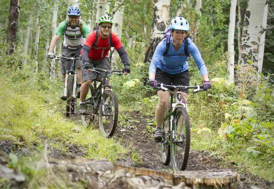 3 people mountain biking