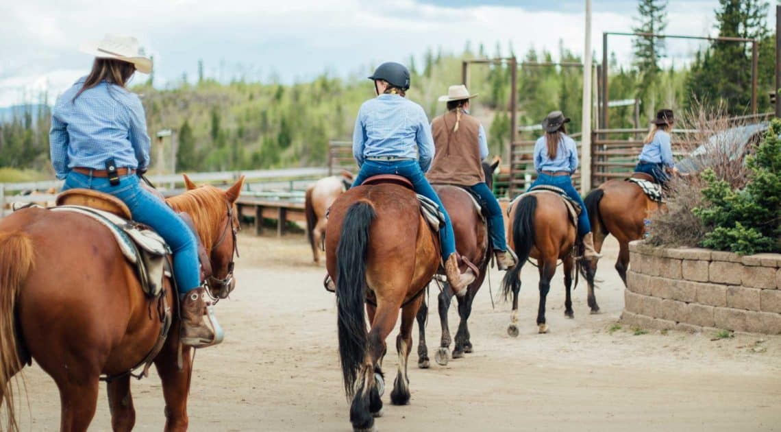 Adult riders heading out for a long trail ride