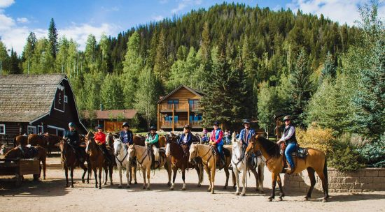 Adults ready for a trail ride during adults-only weekend