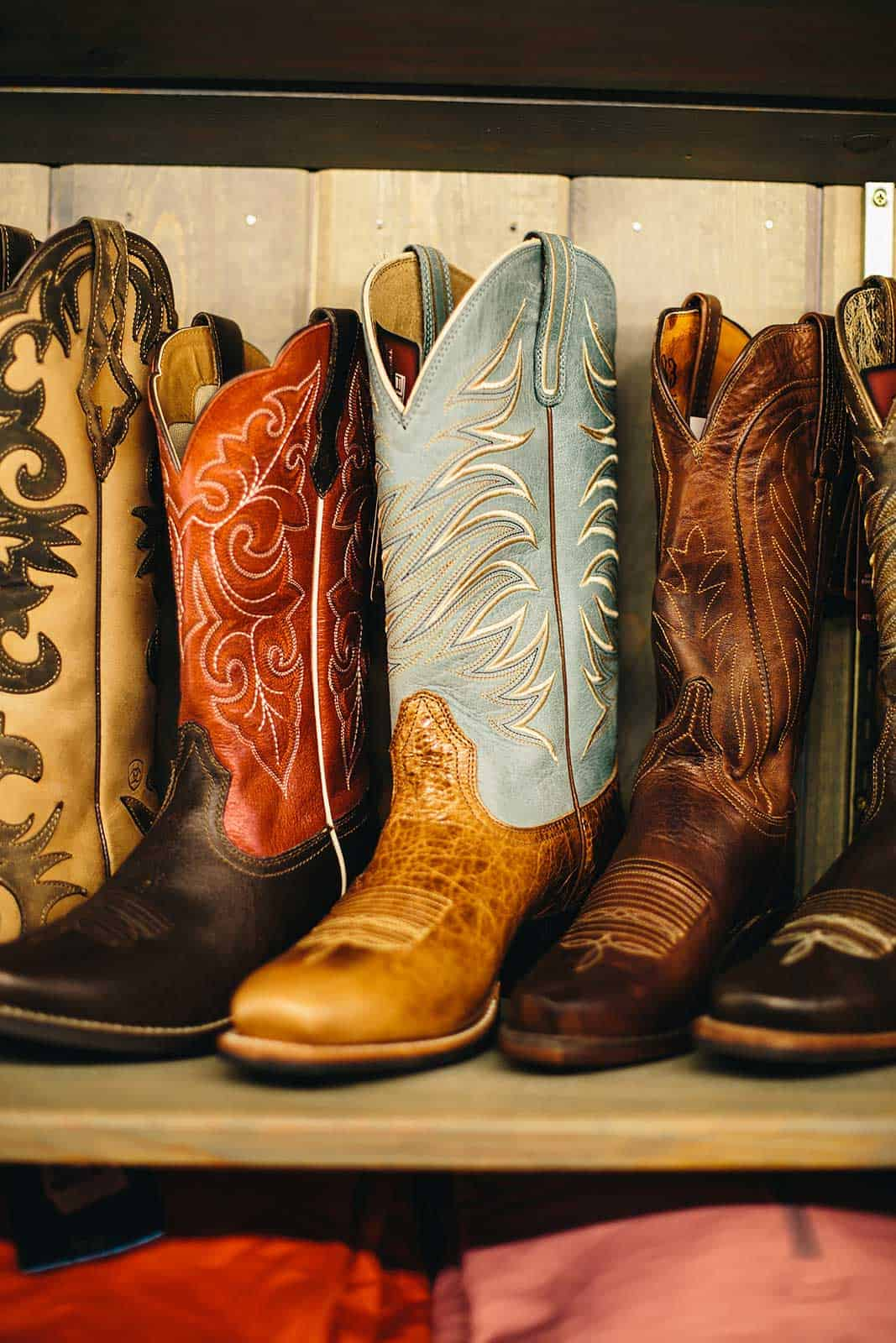 variety of cowboy and cowgirl boots at the ranch store