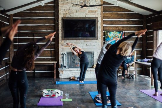 More women doing yoga at retreat at C Lazy U Ranch