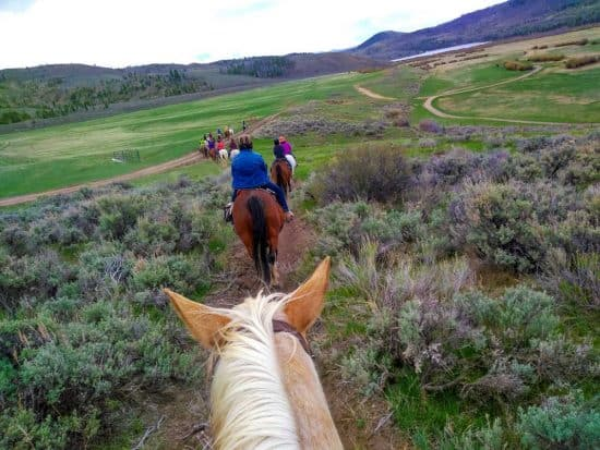 Women on trail ride during the 2018 Cathy Woods retreat