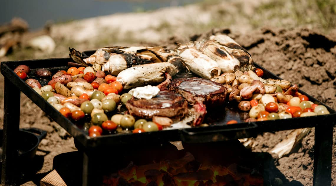 A fresh farm-to-table meal in the making over hot coals by Willow Creek