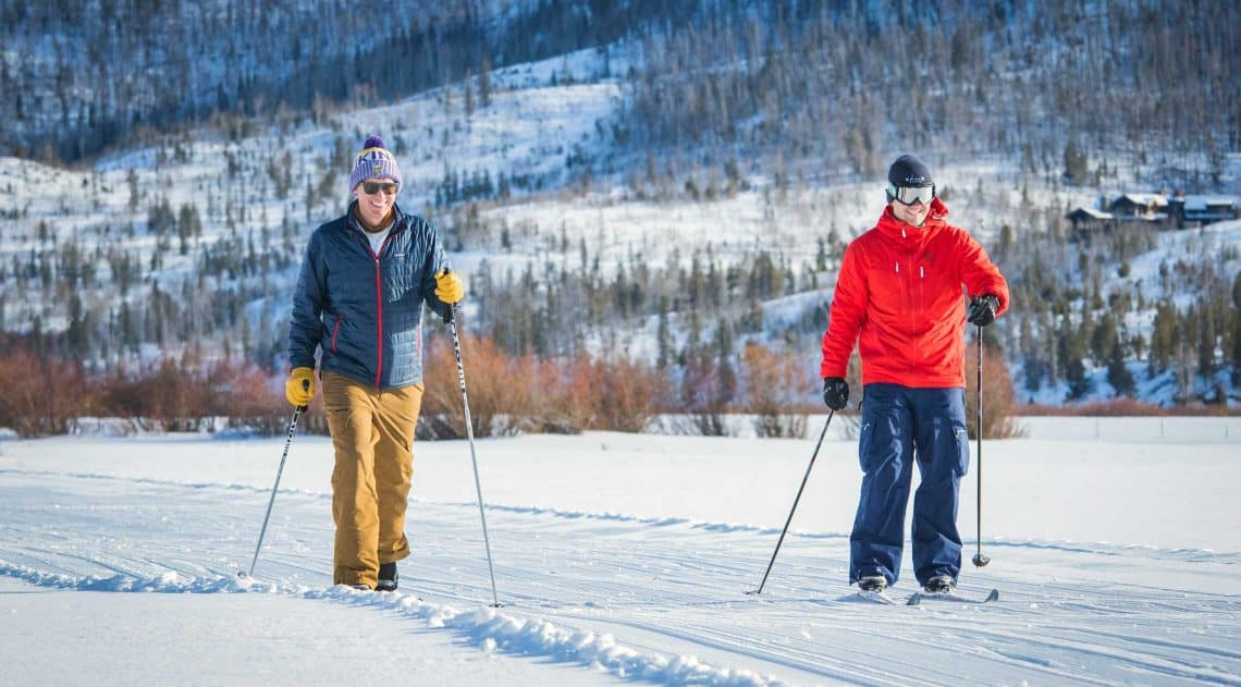 Two men cross country skiing