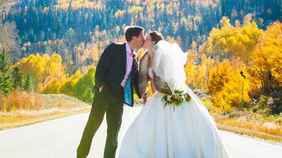 Fall wedding kiss