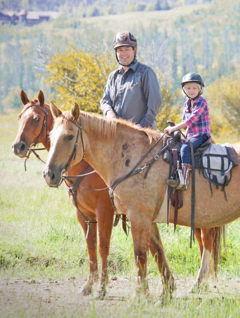 A father and daughter enjoying a trail ride