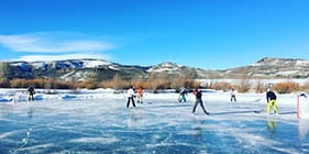Play ice hockey with friends and family during spring break at a dude ranch