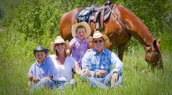 family in front of horse