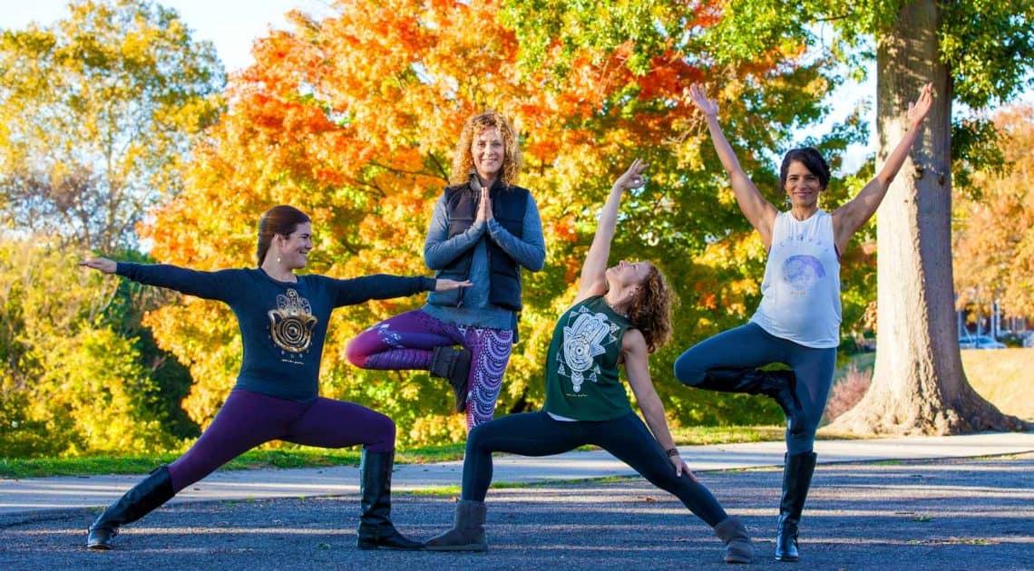4 women doing yoga poses