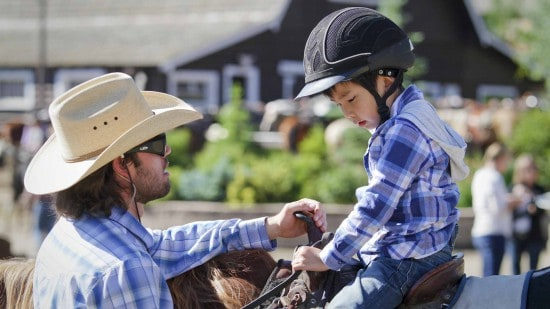 horseback-riding-child-getting-instruction