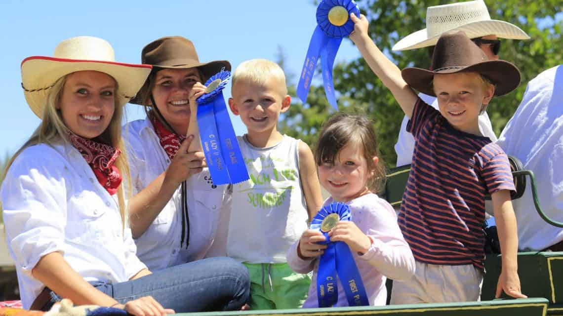 kids show off the ribbons they won during their vacation at C Lazy U