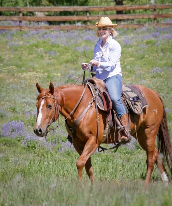 A mom riding a horse for Mothers Day