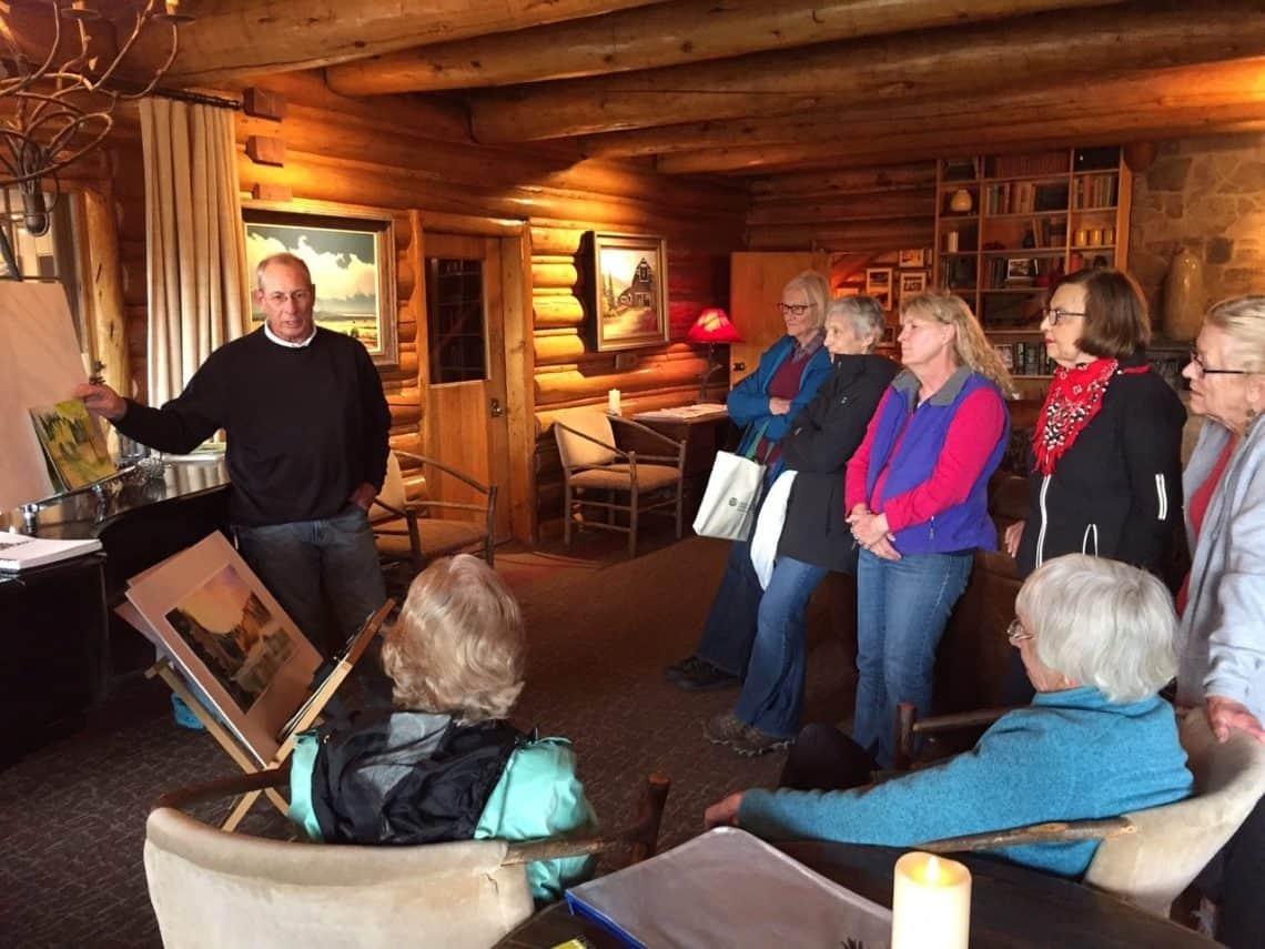 Randy Hale teaching a painting class in the C Lazy U Lodge
