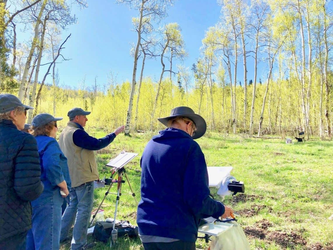 Randy Hale teaching an outdoor painting class amongst the yellow aspens
