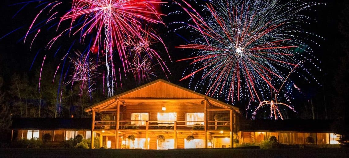 lodge at night with fireworks
