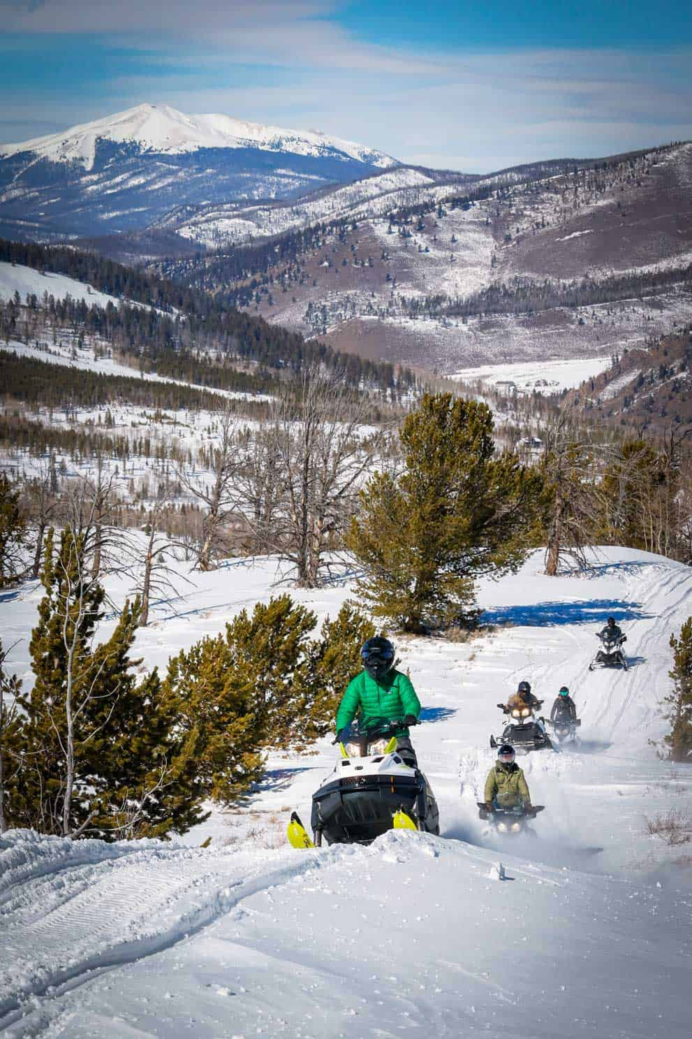 Guests enjoying snowmobiling on miles of groomed trails