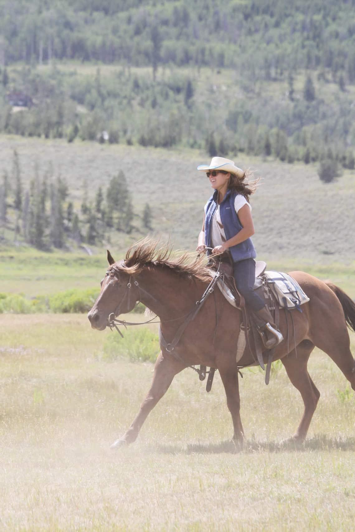 woman on running horse