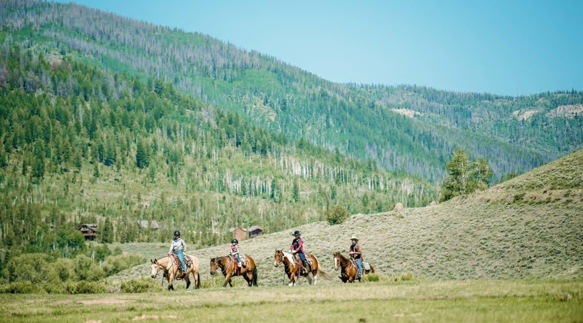 Trail ride under blue skies at C Lazy U Ranch