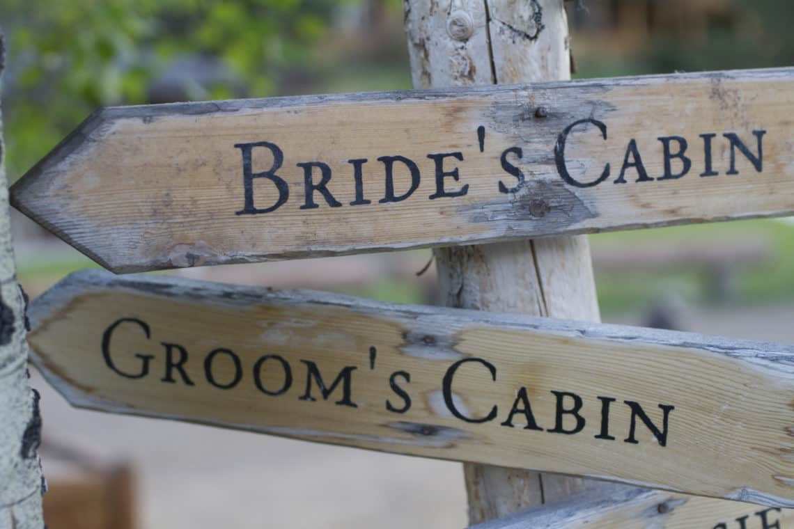 bride and groom cabin signs