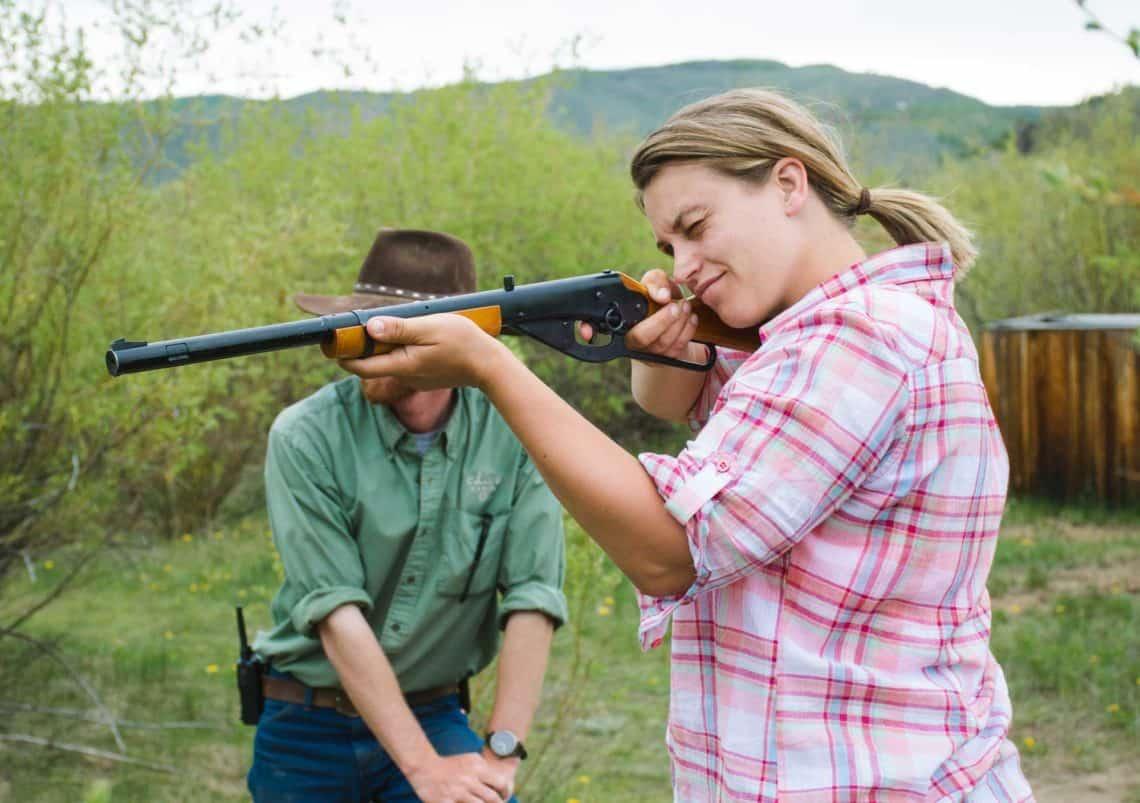 a woman shooting a BB gun